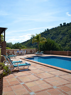 Plenty of room for sunbathing around the pool at Hacienda el Alamo