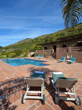 Relax by the pool at holiday villa Hacienda el Alamo, Coin, Andalucia, Spain