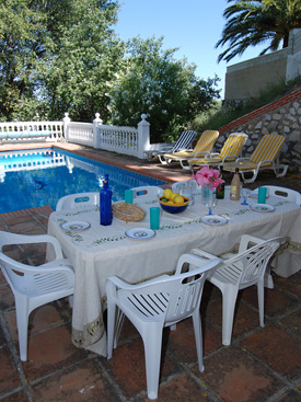 Dine by the pool at Casa Delphin holiday villa in Mijas