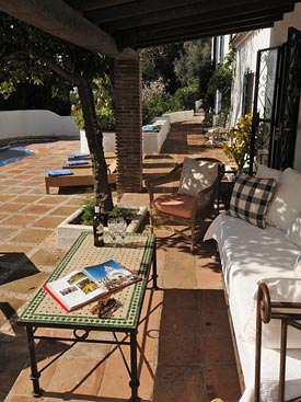 Relax in the shade by the pool at Los Gemelos holiday villa, Mijas