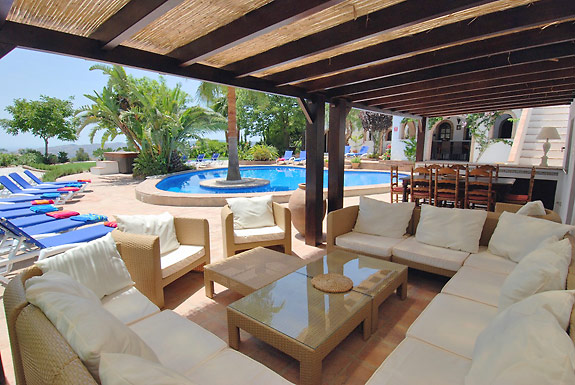 Relax in the shade by the pool at Hueta Vieja