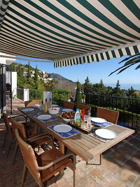 The terrace at Villa Veleta overlooks the pool